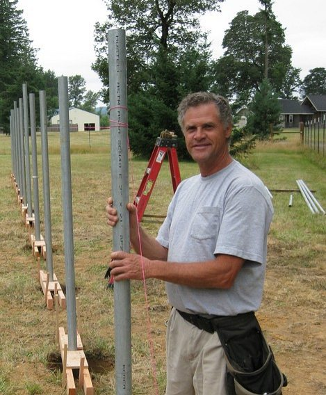Photo of Rocky Thornton installing a solar electric system